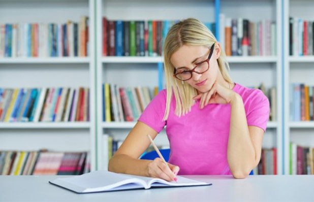 depositphotos_87098988-stock-photo-woman-studying-in-the-lib